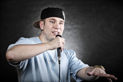 Rap singer man with microphone cool hand gesture Stock Photo