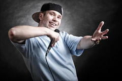 Rap singer man with microphone cool hand gesture Royalty Free Stock Image