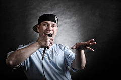 Rap singer man with microphone cool hand gesture Royalty Free Stock Photos