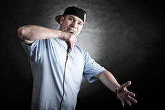 Rap singer man with microphone cool hand gesture Stock Images