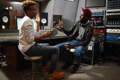 Musician and operator. Rap singer or musician consulting with professional in sound recording about releasing his new album Stock Images