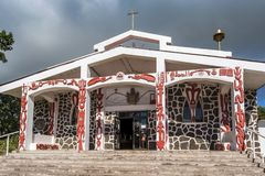 Rapa Nui symboler på väggarna av kyrkan av Hanga Roa royaltyfria foton