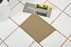 Rapair old tile DIY trowel Stock Photography