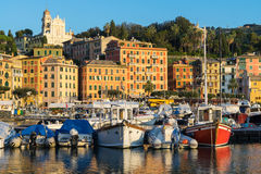 Rapallo, Italy, marina at surise. With colorful boats in harbor Royalty Free Stock Images