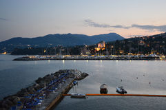 Rapallo seaside resorts at sunset. Rapallo area is included in the Parco Naturale Regionale di Portofino, Liguria, Italy Stock Image