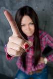 A rapariga agita o dedo Foto de Stock Royalty Free