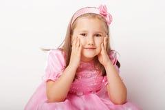 Rapariga agradável na cor-de-rosa Imagem de Stock