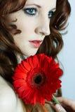 A rapariga bonita com flor Imagem de Stock