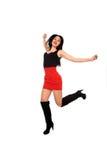 Rapariga bonita com a saia vermelha no ar imagem de stock