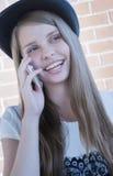 Rapariga bonita com telefone fotografia de stock royalty free