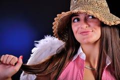 A rapariga bonita com um anjo voa Imagens de Stock