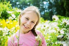 Rapariga bonita em um prado Imagens de Stock