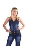 Rapariga bonita em um terno da sarja de Nimes Imagens de Stock
