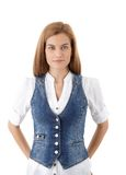 Rapariga bonita no waistcoat da sarja de Nimes fotos de stock royalty free