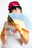 Rapariga bonita que acena um ventilador Imagens de Stock Royalty Free