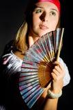 Rapariga bonita que acena um ventilador Imagem de Stock