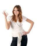 Rapariga bonita que indica o sinal aprovado Imagens de Stock