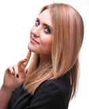 Rapariga bonita que mantem seu dedo em um queixo Fotografia de Stock Royalty Free