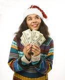 Rapariga bonito no chapéu vermelho de Santa com o dinheiro isolado Foto de Stock Royalty Free