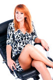 Rapariga charming bonita sobre na poltrona Fotos de Stock