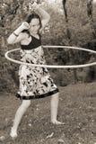 Rapariga com aro do hula fotografia de stock