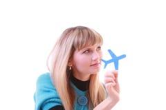 Rapariga com aviões nas mãos Imagem de Stock Royalty Free