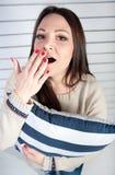 A rapariga com bocejos do prazer Imagens de Stock Royalty Free