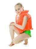 Rapariga com colete salva-vidas imagem de stock