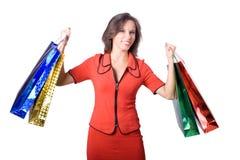 A rapariga com compras durante a compra Imagens de Stock