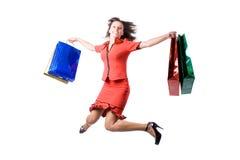 A rapariga com compras durante a compra Fotos de Stock