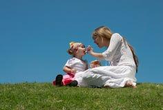 A rapariga com criança Fotos de Stock Royalty Free