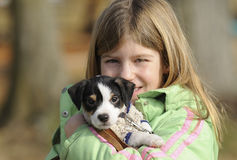 Rapariga com filhote de cachorro Fotos de Stock Royalty Free