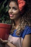 Rapariga com flores Imagens de Stock Royalty Free
