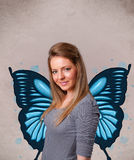 Rapariga com ilustração azul da borboleta na parte traseira Imagens de Stock Royalty Free