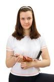 A rapariga com manual perfura dentro as mãos foto de stock