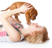 Rapariga com o filhote de cachorro de Dogue de Bordéus Fotografia de Stock Royalty Free