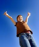 Rapariga com os braços levantados fotografia de stock