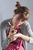 Rapariga com pigtails, e colar colorida Fotografia de Stock Royalty Free