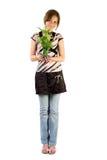 Rapariga com planta home Fotografia de Stock