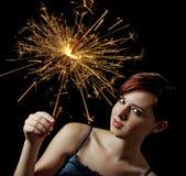 Rapariga com um sparkler Fotografia de Stock Royalty Free