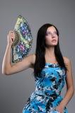A rapariga com um ventilador em uma mão Fotografia de Stock