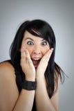 Rapariga com uma expressão da surpresa fotografia de stock royalty free