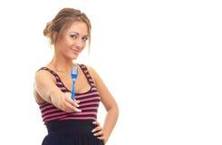 Rapariga com uma forquilha em sua mão Imagens de Stock