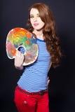 Rapariga com uma paleta e uma escova Foto de Stock Royalty Free
