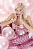 Rapariga como um presente nos balões Fotos de Stock
