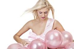 Rapariga como um presente nos balões imagens de stock royalty free