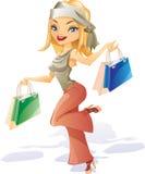 A rapariga de sorriso feliz rinning com sacos Fotografia de Stock