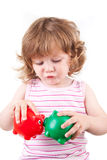 A rapariga deixa seu beijo dos bancos piggy Foto de Stock Royalty Free