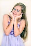 Rapariga do retrato em um vestido da alfazema Imagens de Stock Royalty Free