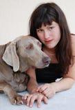 Rapariga e cão Foto de Stock Royalty Free